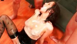 Hot brunette is getting wet from two long dicks pissing on her rough